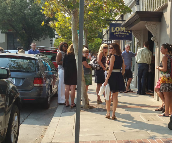 A crowd gathers in Los Gatos for the Loma Brewing Company Grand Opening.