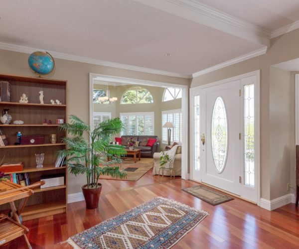 Entryway with large windows and rosewood floors at 211 Westhill Drive