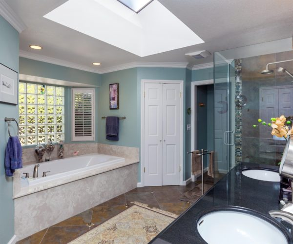 Skylight and brick glass add light even to the master bath.