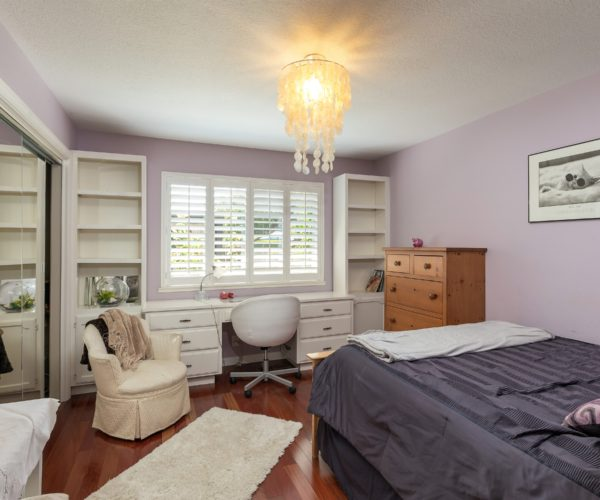 All four bedrooms enjoy large windows and rosewood floors