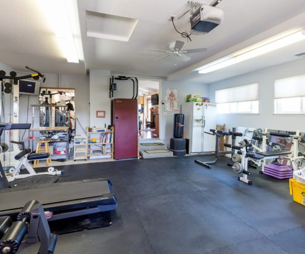 Currently a home gym, even the three car garage is bright and inviting.