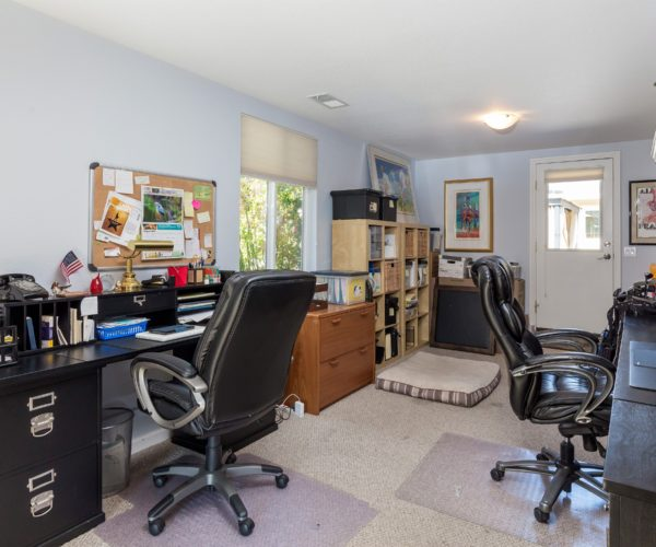 The home office has lots of space for work, craft, or study.